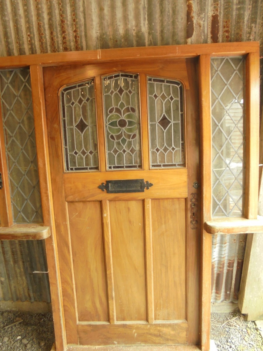 Reclaimed hard wood front door with stained glass for Recycled front doors