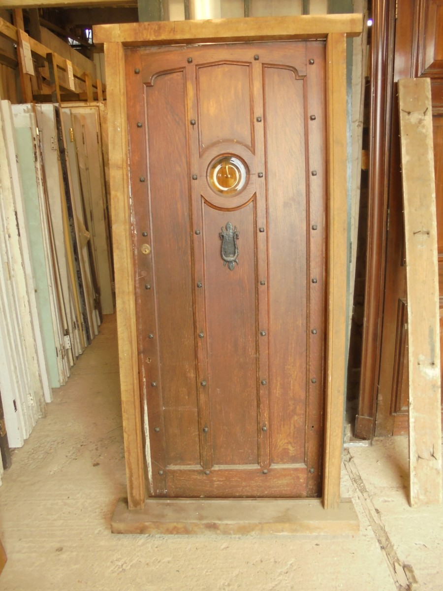 Studded Oak Front Door With Oval Window Authentic Reclamation