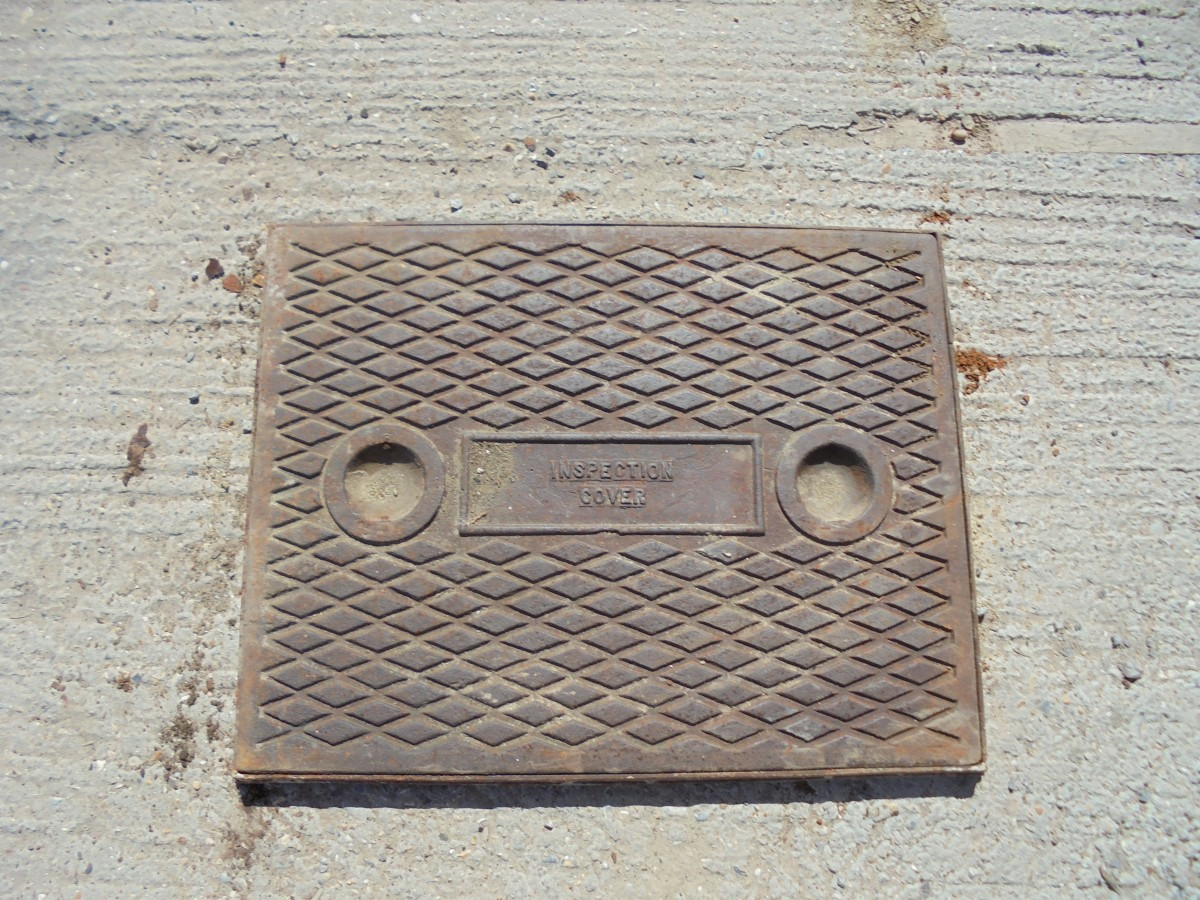 Reclaimed cast iron inspection cover authentic reclamation