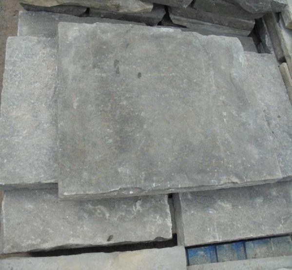 Weathered reclaimed york paving slabs