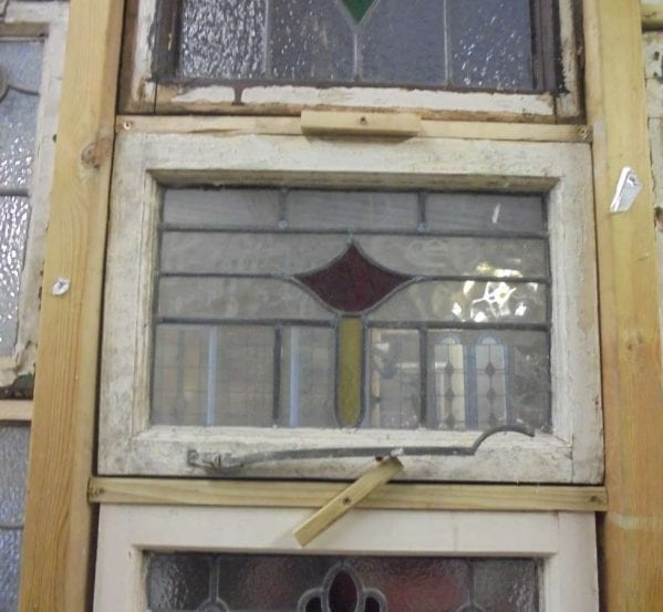 Stained glass window with latch