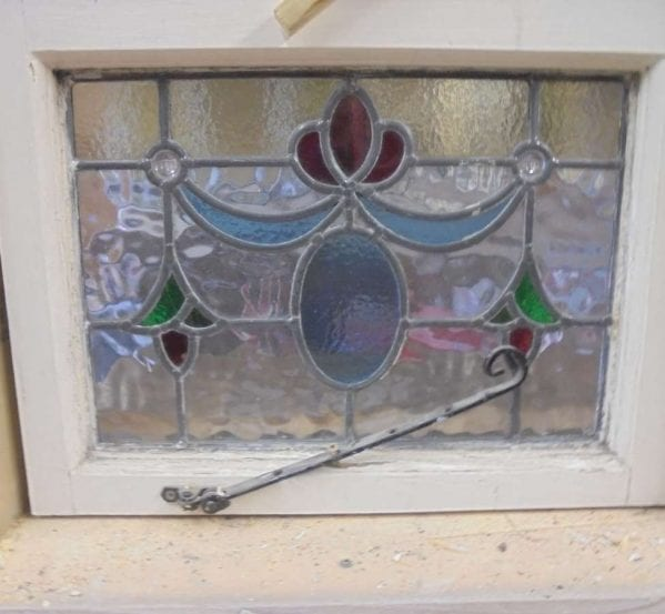 Multi-coloured stain glass window with latch