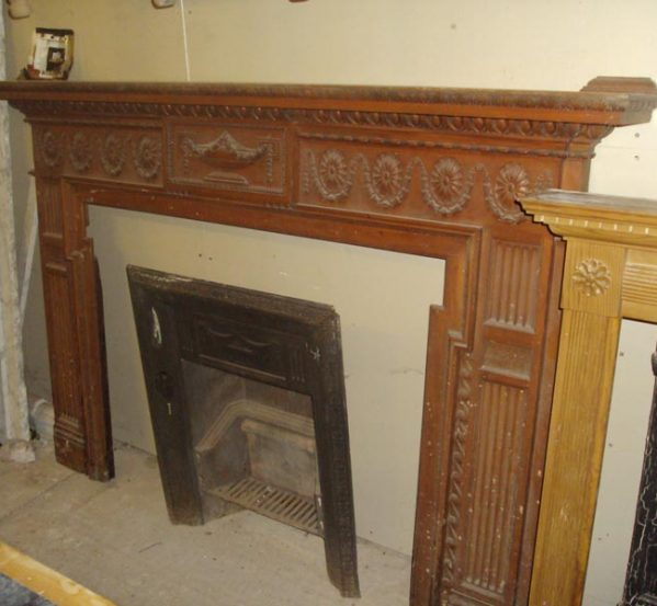 intricately carved wooden fire surround