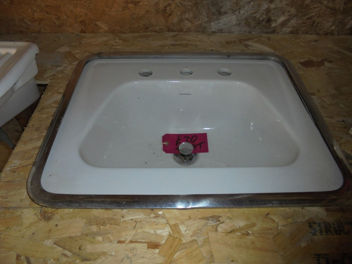 Salvaged Sink With Metal Trim Authentic Reclamation