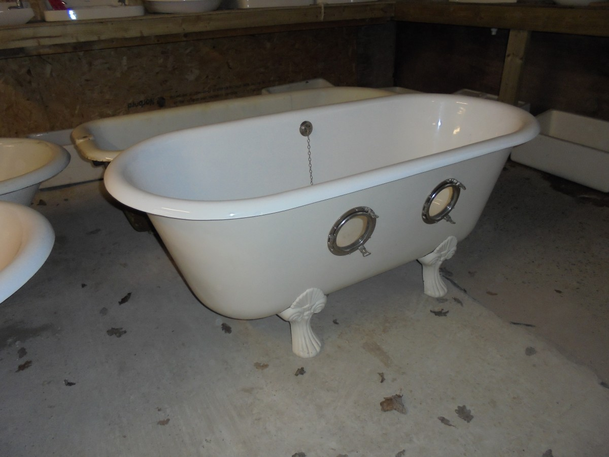 reclaimed double ended roll top bath with port holes in the side ...