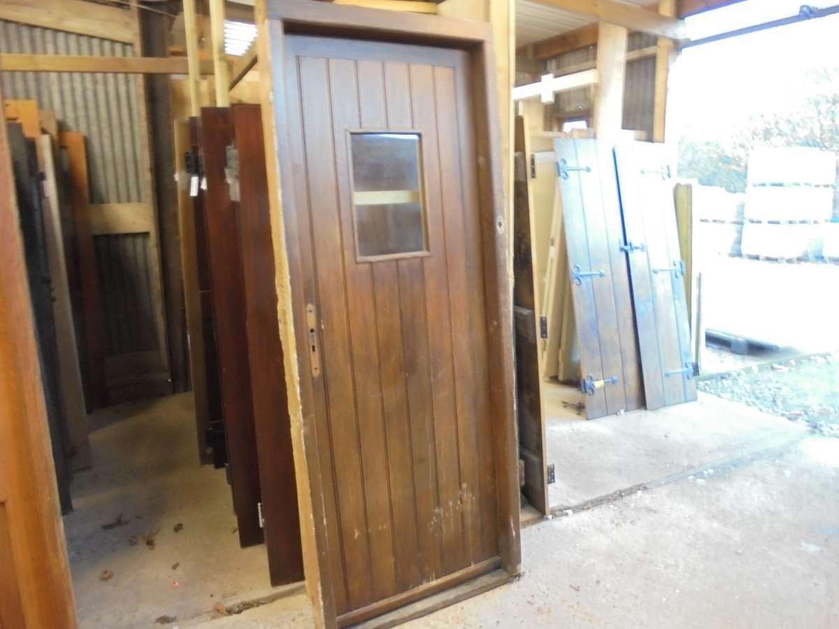 Ledge and brace oak doors - An Oak Ledge Brace Door With A Small Window In Its Frame