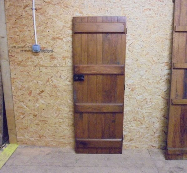 a salvaged varnished ledged door