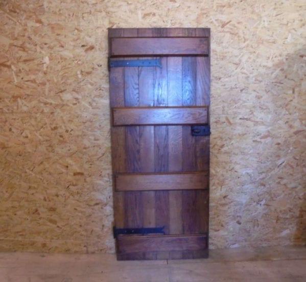 a reclaimed varnished ledge door