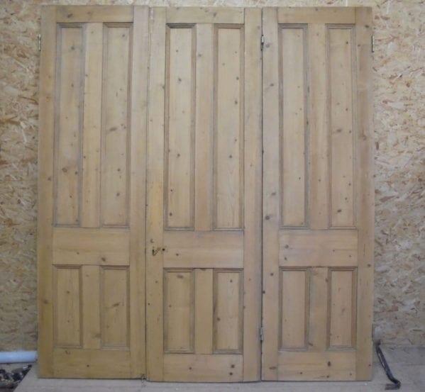 Tall Stripped Tri-fold Doors