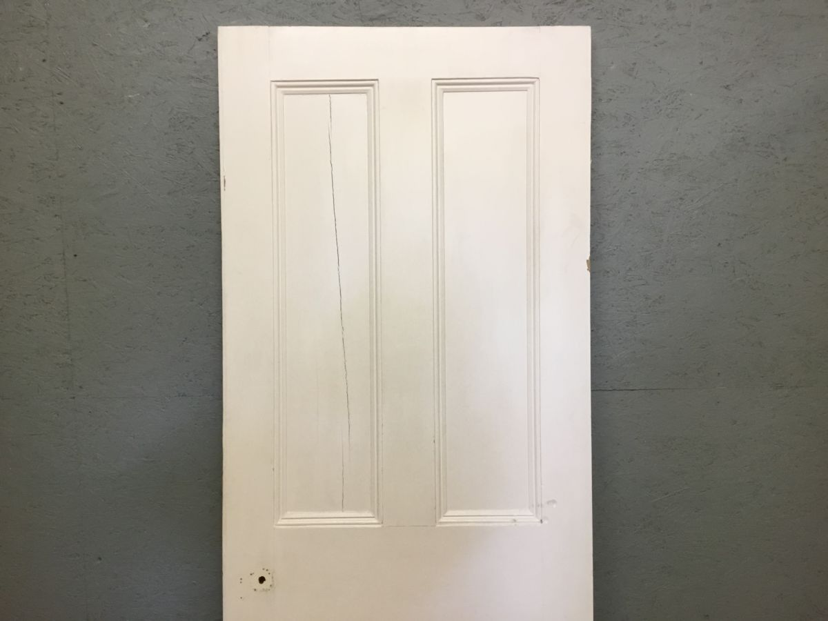 White 4 Panelled Door Cracked