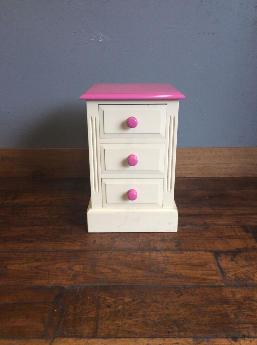 Pink Three Drawer Bedside Table