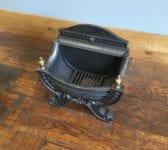 Small Regency Style Cast Iron Fire Basket